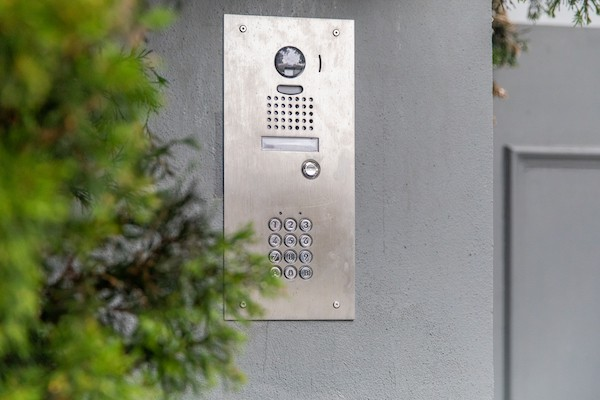 Photograph of Video Intercom Systems on a building with a tree in the foreground