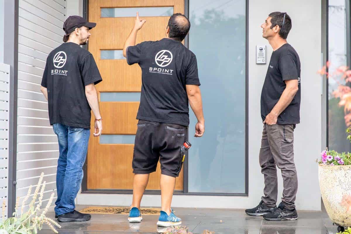 technicians planning security camera installation